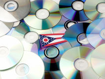 Ohio flag on top of CD and DVD pile isolated on white. Ohio flag on top of CD and DVD pile isolated Stock Photography