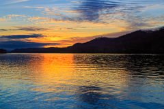 Ohio River Sunset. The setting sun silhouettes hills as it reflects upon the waters of the Ohio River as seen from Paden City, West Virginia stock images