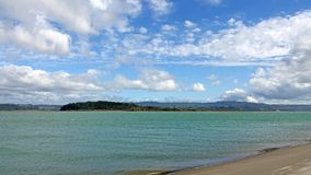 Ohiwa from Ohope beach in Whakatane, New Zealand. Tasman sea at Ohiwa beach in the Bay of Plenty on the North Island of New Zealand is voted as New Zealand royalty free stock photography