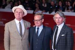 Ohn C Reilly, Steve Coogan och Jon Baird på den röda mattan royaltyfria bilder