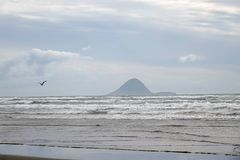 Moutohora or Whale Island from Ohope beach in Whakatane, New Zealand. Ohope beach in the Bay of Plenty on the North Island of New Zealand is voted as New Zealand stock images