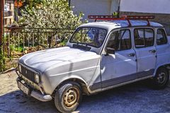 Vintage and obsolete car parked in a street of Ohrid, Macedonia Royalty Free Stock Photo