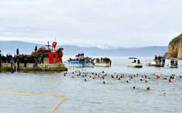 OHRID, MACEDONIA - JANUARY 19, 2017: Men swim in the cold water to retrieve the cross at the Epiphany in Ohrid, Macedonia. OHRID, MACEDONIA - JANUARY 19, 2017 Stock Photo