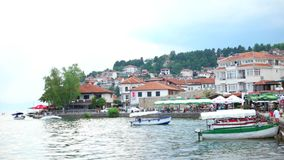 OHRID, MACEDONIA, JUNE 2015: Everyday scene from Ohrid city of Macedonia which is famous for its unesco listed historical center. And beautiful lake separating stock video