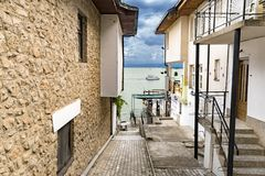 Ohrid, Macedonia - Traditional street alley passage with old house architecture at Kaneo beach Royalty Free Stock Photos
