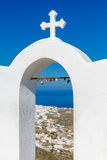 Oia. Aerial view of the village from above. The church arch with cross on top of a mountain over  island Santorini and  village Oia. Greece Stock Images