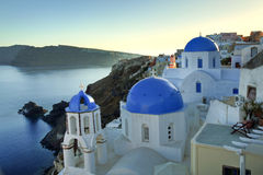 Oia blue dome church in Santorini Island, Greece. Oia blue dome church in santorini island Greece during sunset royalty free stock photos