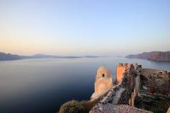 Oia castle at sunrise Stock Photos