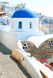 Oia church with blue cupola on Santorini island, Cyclades, Greec. E Stock Photo