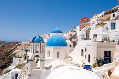 Oia church with blue domes and the bell on the island of Santorini, Greece Stock Image