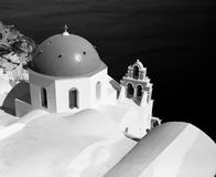 Oia Church Dome. One of the famed blue church domes of Oia on the island of Santorini in the Greek Islands is highlighted against the water in the background. ( Royalty Free Stock Images