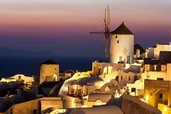 Oia at dusk, with beautiful windmill, Santorini island, Greece Royalty Free Stock Photos
