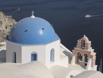 Oia, Greece. Greece, Cyclades Islands, Santorini. Oia village, White Churches with blue dome in front of the sea Royalty Free Stock Photography