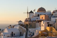 People wating for sunset in Oia Stock Photos