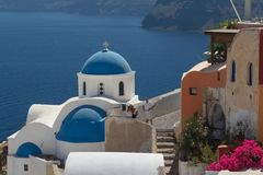 Traditional church in Cyclades style. OIA / GREECE - AUGUST 2014: Traditional church in Cyclades style, Oia village, Santorini island, Greece Royalty Free Stock Images