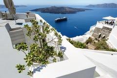 Oia luxury decks and patios. Luxury decks and patios of Oia, Santorini, Greece, selective focus atplant Royalty Free Stock Photography
