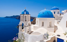 Oia Orthodox churches and the bell tower on Santorini island, Greece. Royalty Free Stock Photo