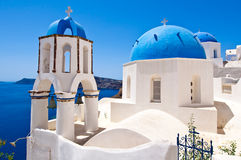 Oia Orthodox churches domes and the bell-tower. Santorini island, Greece. Stock Photo