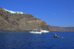 Yachts in Santorini gulf,Greece Stock Photos