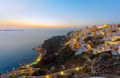 Oia and Ammoudi after sunset Stock Photos