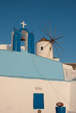 Oia, Santorini. A church and a windmill in Oia, Santorini, Greece Royalty Free Stock Photography