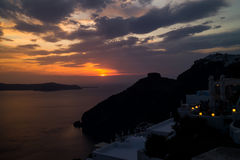 Oia Santorini famous with romantic and beautiful sunsets Stock Images