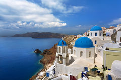 Oia, Santorini. Greece. Cyclades Islands - Santorini (Thira). Oia town with characteristic painted blue cupolas and white walls of houses Royalty Free Stock Photography