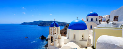 Oia Santorini Greece Europe. Panoramic shot of the Blue domed church at Oia Santorini Greece Europe Stock Image