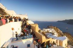 Oia, Santorini, Greece- May 13, 2015: A crowd awaits tourists th Stock Image