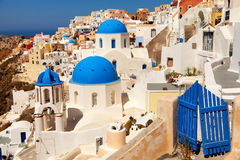 Oia, Santorini. Landscape of Oia town in Santorini, Greece with blue dome churches and small doors on foreground Royalty Free Stock Image
