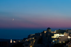 Oia after sunset. Oia of Santorini after sunset with moo Stock Images