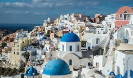 Oia town on the Greek island of Santorini. White-washed buildings and blue-domed churches on the island of Santorini in Greece Royalty Free Stock Photography