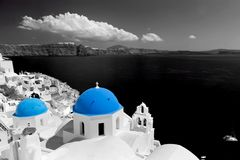 Oia town on Santorini island, Greece. Blue dome church Stock Images