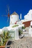 Windmill on the streets of Oia, santorini, Greece, Caldera,Aegea Royalty Free Stock Images