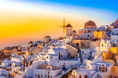 Oia town, Santorini island, Greece at sunset. Traditional and fa Stock Photos