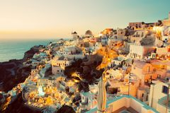 Oia town on Santorini island, Greece at sunset Royalty Free Stock Photo