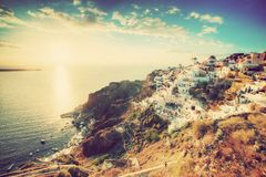 Oia town on Santorini island, Greece at sunset. Royalty Free Stock Photo