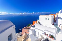 Oia town on Santorini island, Greece. Traditional and famous houses and churches with blue domes over the Caldera. Oia town on Santorini island, Greece royalty free stock images