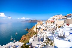 Oia town on Santorini island, Greece. Traditional and famous houses and churches with blue domes over the Caldera, Aegean sea stock photos