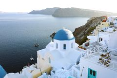 Oia town on Santorini island, Greece. Traditional and famous houses and churches with blue domes over the Caldera, Aegean sea, royalty free stock image