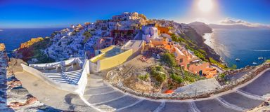 Oia town on Santorini island, Greece. Traditional and famous houses and churches with blue domes over the Caldera. Royalty Free Stock Photos