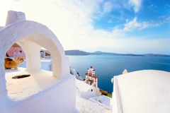 Oia town on Santorini island, Greece. Traditional and famous houses and churches with blue domes over the Caldera. Stock Images
