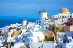 Oia town on Santorini island, Greece. Traditional and famous houses and churches with blue domes over the Caldera. Royalty Free Stock Photography