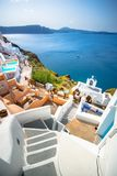 Oia town on Santorini island, Greece. Traditional and famous houses and churches with blue domes over the Caldera. Stock Photography