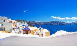 Oia town on Santorini island, Greece. Traditional and famous houses and churches with blue domes over the Caldera. Oia town on Santorini island, Greece stock image