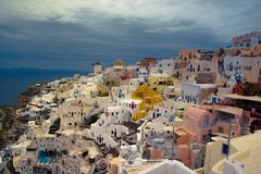 Oia town on Santorini island, Greece. Traditional and famous houses and churches with blue domes over the Caldera. Royalty Free Stock Photo