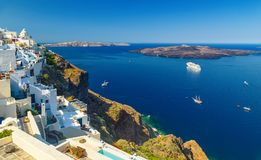Oia town on Santorini island, Greece. Traditional and famous white houses and churches with blue domes over the Caldera, Aegean se. Oia town on Santorini island stock photo