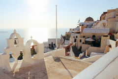 Oia town on Santorini island, Greece. Traditional houses and sea in sunset time. Travel landscape Stock Images