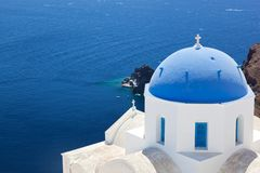 Oia town on Santorini island, Greece. White church with blue dome. Royalty Free Stock Photos