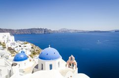 Oia town with typical Cycladic churches stock photography